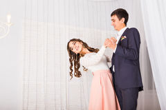 Young couple dancing in empty room Royalty Free Stock Image