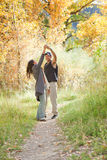 Young couple dancing in fall forest. Young couple dancing in colorful autumn forest Royalty Free Stock Photo
