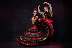 Young couple dancing flamenco, studio shot. Royalty Free Stock Images