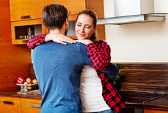 Young couple dancing and having fun in the kitchen Stock Image