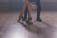 Young couple dancing latin dance Bachata, merengue, salsa. Two elegance pose in dance class close up Stock Image