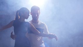 Young couple dancing latin music