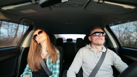 Young couple dancing like crazy while driving car after success. HD stock video footage