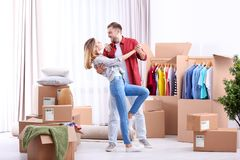 Young couple dancing near wardrobe boxes royalty free stock image