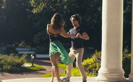 Young couple dancing in the park. In summer Royalty Free Stock Images