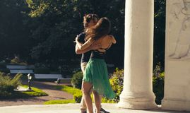 Young couple dancing in the park. In summer Royalty Free Stock Image