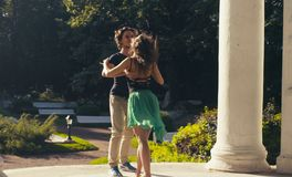 Young couple dancing in the park. In summer Stock Image