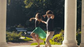 Young couple dancing in the park. In summer Stock Photo