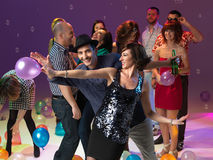 Young couple dancing at party Stock Images