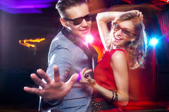 Young couple dancing at party stock image