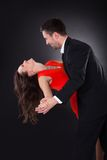 Young Couple Dancing. Portrait Of A Happy Couple Dancing On Black Background royalty free stock photo