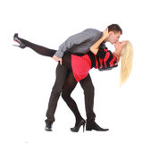 Young couple on dancing pose is kissing Stock Photos