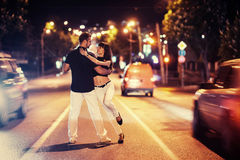 Young couple dancing on the road Royalty Free Stock Photo