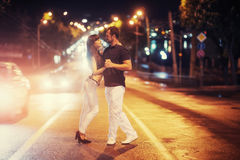 Young couple dancing on the road. Royalty Free Stock Image