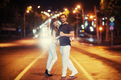Young couple dancing on the road. Stock Photography