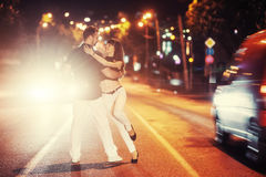 Young couple dancing on the road. Royalty Free Stock Photos