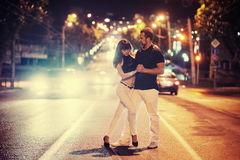 Young couple dancing on the road Royalty Free Stock Image
