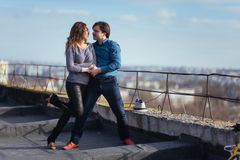 Young couple dancing on the roof of a tall building Stock Image