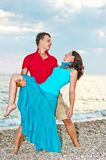 Young couple dancing on sea beach Royalty Free Stock Photo
