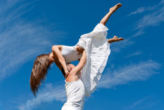 Young couple dancing on sky background, freedom Royalty Free Stock Photography