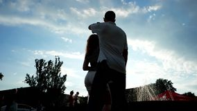 Young couple dancing on the square stock video footage