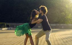 Young couple dancing on the square. In the park in summer stock photos