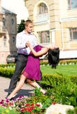 Young couple dancing on street Stock Photo