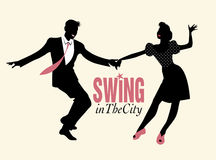 Young couple dancing swing or lindy hop. Handsome man and pin-up girl dancing swing Royalty Free Stock Images