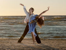 Young couple dancing tango Stock Photos