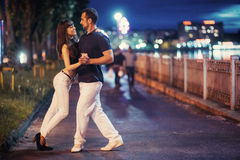 Young couple dancing tango on the embankment Royalty Free Stock Images