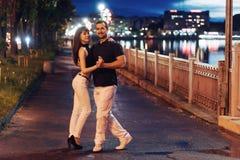 Young couple dancing tango on the embankment Stock Photo