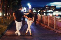Young couple dancing tango on the embankment Royalty Free Stock Photo