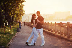 Young couple dancing tango on the embankment Stock Photos