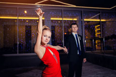 Young couple dancing tango outdoors Stock Images