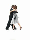 Young couple dancing the tango, white background Royalty Free Stock Images