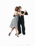 Young couple dancing the tango, white background Stock Photography