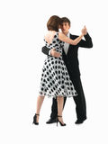 Young couple dancing the tango, white background Stock Photos