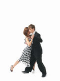 Young couple dancing the tango, white background Royalty Free Stock Photography