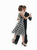 Young couple dancing the tango, white background Stock Photo
