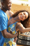 Young Couple Dancing Together In Living Room Stock Photos