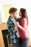 Young Couple Dancing Together In Living Room Stock Images