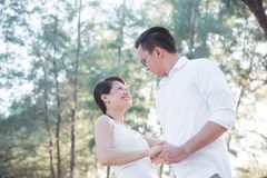 Young couple dancing together in park Stock Photos