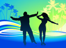 Young couple dancing on tropical background Stock Images