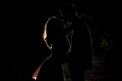 Young couple in the dark Royalty Free Stock Photo