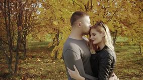 Young couple on a date in the autumn park. HD stock video footage