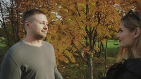 Young couple on a date in the autumn park. HD stock footage