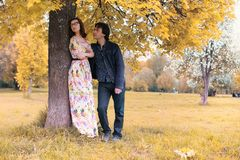 Young couple on date in autumn park Royalty Free Stock Photography