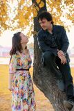 Young couple on date in autumn park Royalty Free Stock Photos