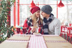 Young couple on a date. Indoors royalty free stock images
