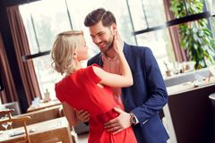 Young couple on date in restaurant dancing. Young men and women on date in restaurant dancing together stock images